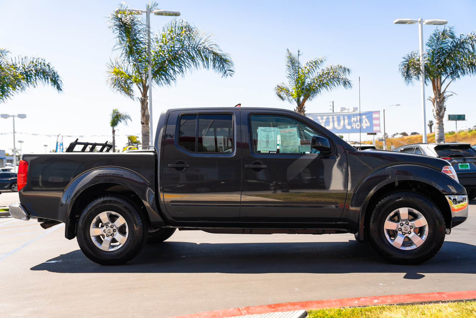 Pre-Owned 2010 Nissan Frontier 4WD Crew Cab SWB Auto SE